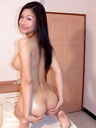 Ladyboy Natalie loves to lube up and touch herself.