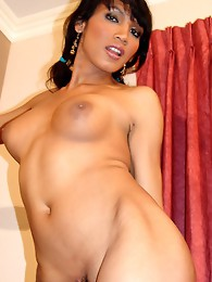 Gorgeous Asian tgirl strips to show off her thick cock!